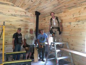 Volunteers working on the new cabin interior